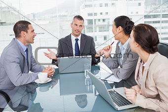 Business people working together with their laptop