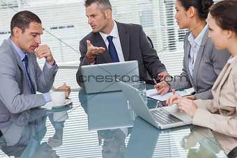 Business people interacting and working together