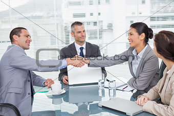 Smiling business people shaking hands