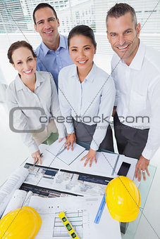 Smiling architect team posing while working together