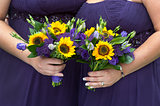 bridesmaids in purple with sunflower bouquets