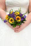 bride holding a sunflower bouquet