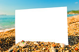 blank sheet of paper on a beach