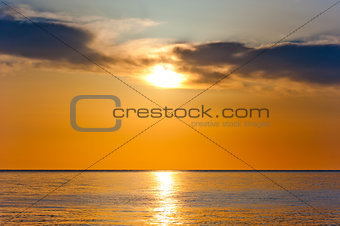 sunset in orange tones over a calm sea