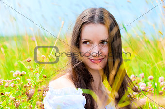 beautiful young girl in a field of flowers