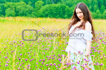 beautiful girl standing in a field