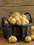 fresh organic potatoes on a wooden background, rustic style