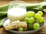 bar muesli with milk and fruits - healthy breakfast