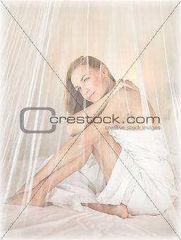 Beautiful woman in romantic bedroom