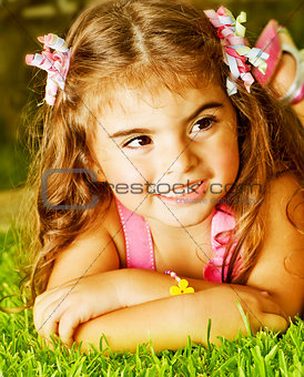 Little girl on green grass