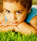Small boy on green grass