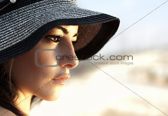 Attractive female wearing hat