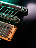 Electric guitar strings and bridge closeup