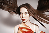 Photo of beautiful asian woman with magnificent hair. Fashion