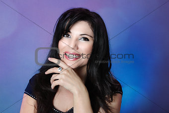 Beautiful woman with glossy black hair and big happy smile