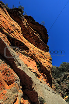 Awe inspiring red cliffs along the National Pass - Australia
