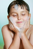 Young boy child washing cleansing face soap and water