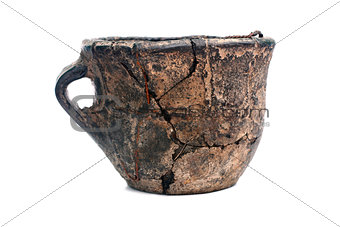 Old cracked ceramic cup