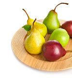 fresh pears on the wooden plate