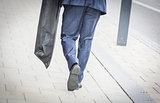 Suited man walking
