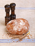 Traditional bread with salt and pepper shaker
