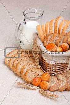 Assorted sliced bakery products and milk