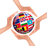 Hands holding globe with flags of world. Vector.