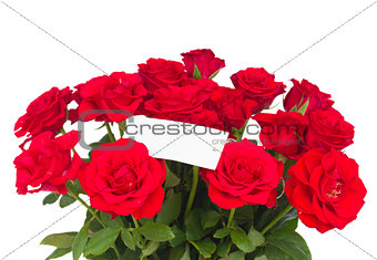 bouquet of scarlet roses with tag