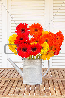 bouquet of gerbera flowers on wooden table