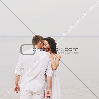 sensual couple at sea