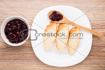 Slices of baguette with cherry jam