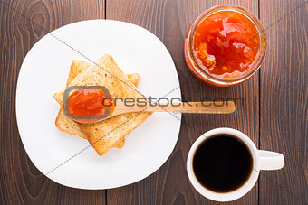 Breakfast with tea, toast and apricot jam