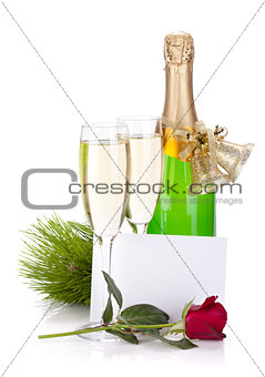 Champagne, empty card and rose flower