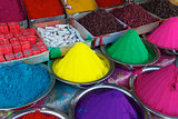 Colorful piles of Indian bindi powder at outdoor market