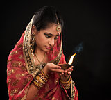 Diwali Indian woman with oil lamp