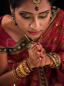 Close up Indian woman prayer