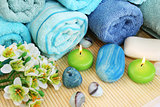 Towels, soaps, flower, candles