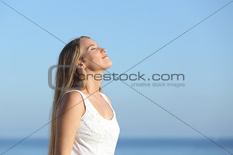 Beautiful blonde woman breathing happy
