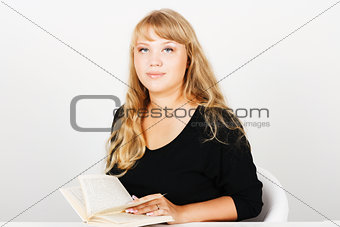 Attractive girl with a book