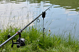 Close up photo of angling rod over the water