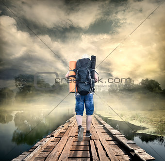 Tourist on the wooden bridge