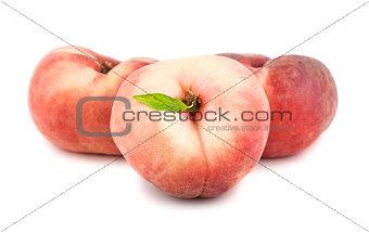 Three flat peaches