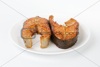 fried trout steaks on plate