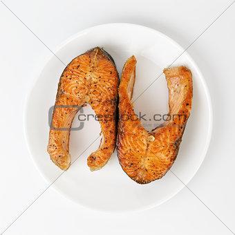 fried trout steaks on plate