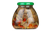 Glass jar with marinated suillus mushrooms