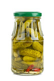Glass jar with marinated cornichons