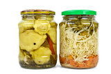 Glass jars with marinated cymblings and vegetable assortment