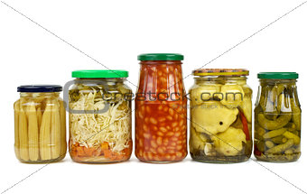 Five glass jars with marinated vegetables