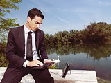 businessman using laptop outdoors b
