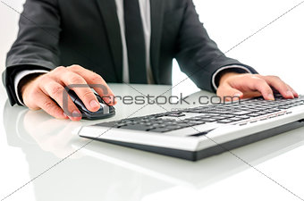 Businessman at office desk working on computer